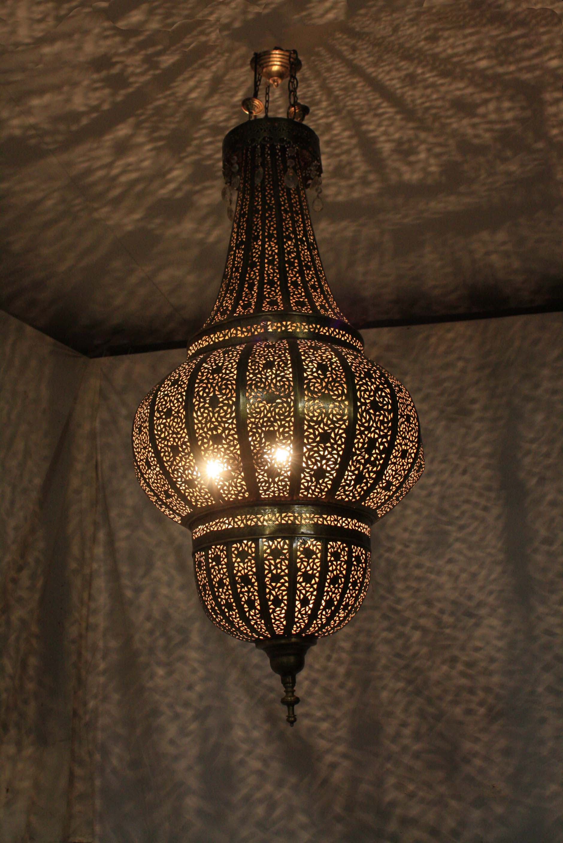 Moroccan hand punched chandelier moroccan themed party rentals - Improve your home decor with moroccan lamps ...